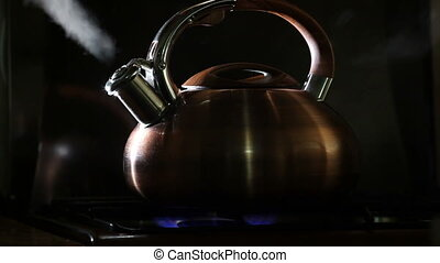 boiling kettle on a black background 5