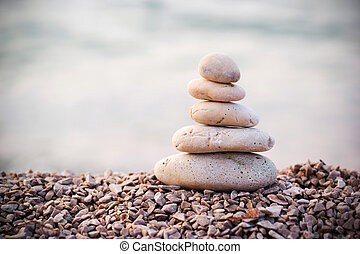 Stack of pebbles by the sea