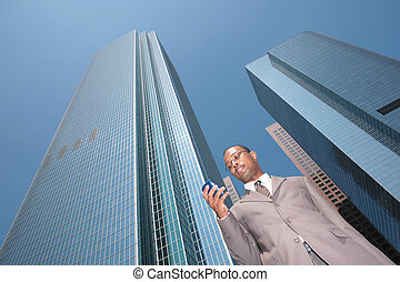Black Business Man in a Suit Outdoors - Abstract View of...