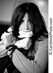 Beautiful woman being hold hostage domestic violence black and white