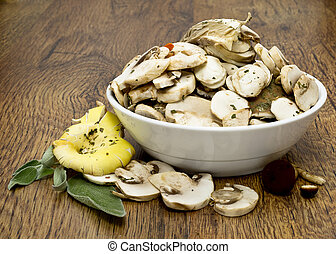 Sliced mashrooms for cooking on wooden table