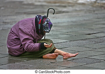 Help - An old woman begging for a couple of coins - for a...