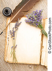 Old book with lavender flowers - Opened old book with...