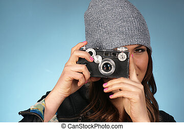 Hip Woman Snaps a Picture of Viewer with Vintage Camera