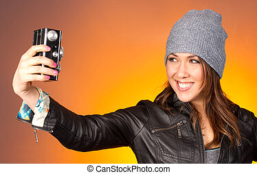 Hip Woman Snaps a Self Portrait with Vintage Camera