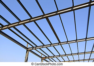 steel structure framework under the blue sky in a factory,...