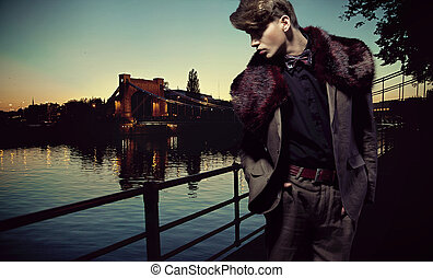Handsome man with bridge over the background