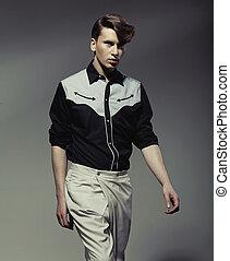 Handsome man wearing black&white shirt
