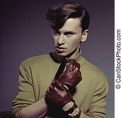 Fashion photo shot of a man wearing gloves - Fashion photo...