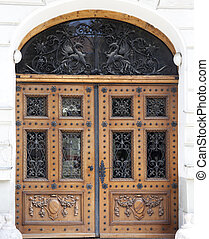 Entrance door - old brows wood entrance door with carving...