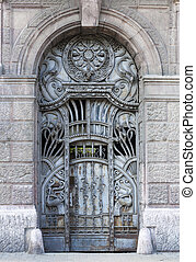 Iron Gate - old blue iron entrance door with carving and...