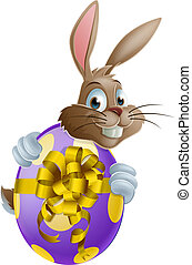 Easter bunny and egg - Cute Easter bunny cartoon character...