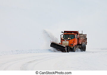 Snow plough clearing road in winter storm blizzard - Snow...