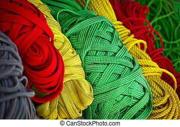Colored threads - Heap of colored threads in the market in...