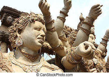 durga and demon sculpture