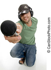 smart male showing microphone on an isolated white...