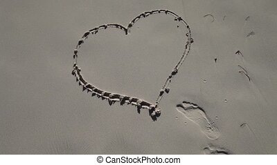 Love - heart in sand is washed away