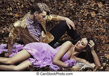 Fashionable and attractive young couple with autumn in...