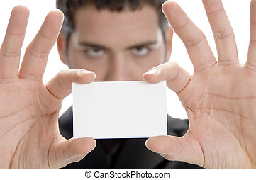 businessman holding his visiting card, close up view