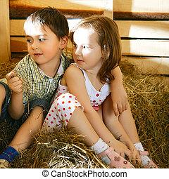 Children on Hayloft - beautiful children on hayloft at sunny...