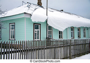 house roof covered with snow