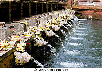 holy spring water in tirta empul, bali, indonesia