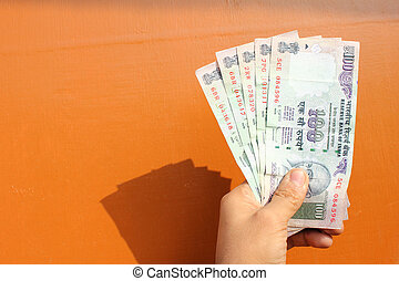 indian money with wooden background