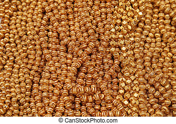 Gold Beads at the Otavalo Market - Handmade gold necklaces...