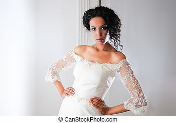 Young black woman, model of fashion, with wedding dress