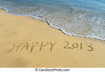 """New year background with """"2013"""" drawn in the sand"""