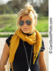 Young Blonde with sunglasses - Young blonde girl posing with...