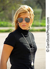 Young Blonde Girl with sunglasses