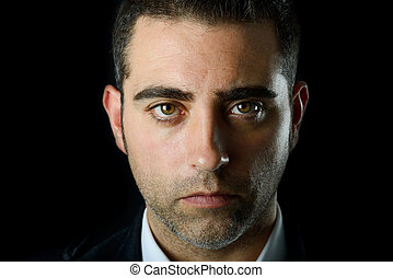 Serious man - Close up studio portrait of a serious man on...