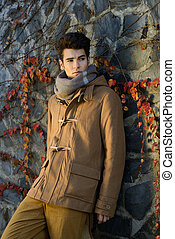 Portrait of a young handsome man, model of fashion, with...