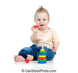 happy baby boy playing with colorful toy isolated on white backg