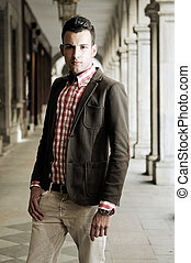 Young handsome man, model of fashion, wearing jacket and...