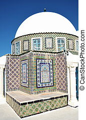 Domed building with decorated tiles, typical of Tunisia