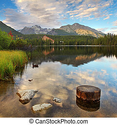 Mountain Lake in Slovakia Tatra - Strbske Pleso with dramatic clouds
