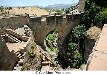 Roman bridge in Ronda, one of the famous white villages in...