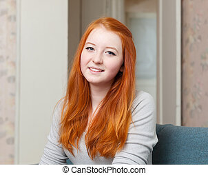 red-haired teenager girl at home - Portrait of red-haired...