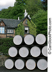 Whisky distillery in Scotland - Whisky barrels outside old...