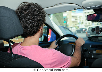 Young man driving a car - Portrait of a young man driving a...