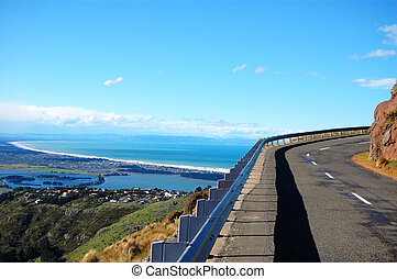 Road turn ocean view Christchurch, New Zealand