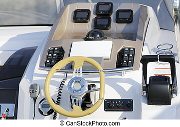 Motorboat cockpit - Instruments panel and steering wheel of...