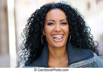 Young black woman smiling with braces - Portrait of a young...