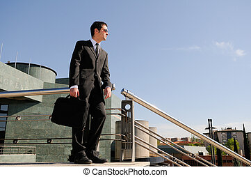 Businessman holding a briefcase - A young businessman...