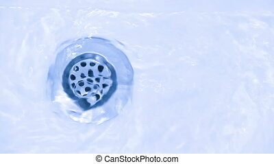 Water down the drain - water running down the drain, turning...