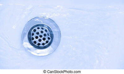 Water down the drain - water running down the drain, small...