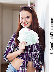 happy housewife with many euro - Portrait of happy housewife...