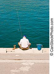 fishing - old man fishing in Benalmadena, Spain